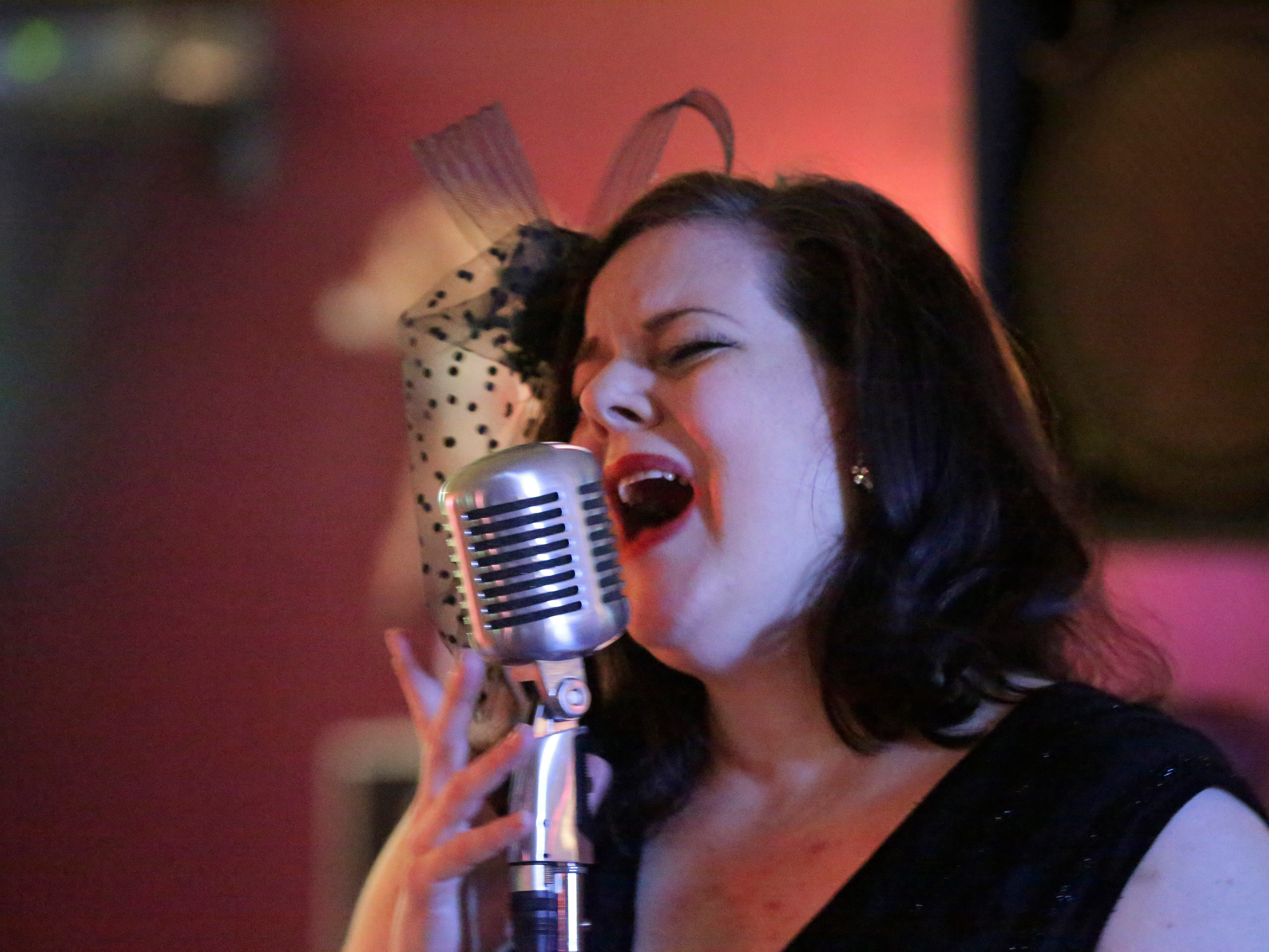 Chanel Le Meaux snarls out the jazz at Wild Shots Pub during the Jazz Crawl, Friday, August 10, 2018, in Plymouth, Wis.