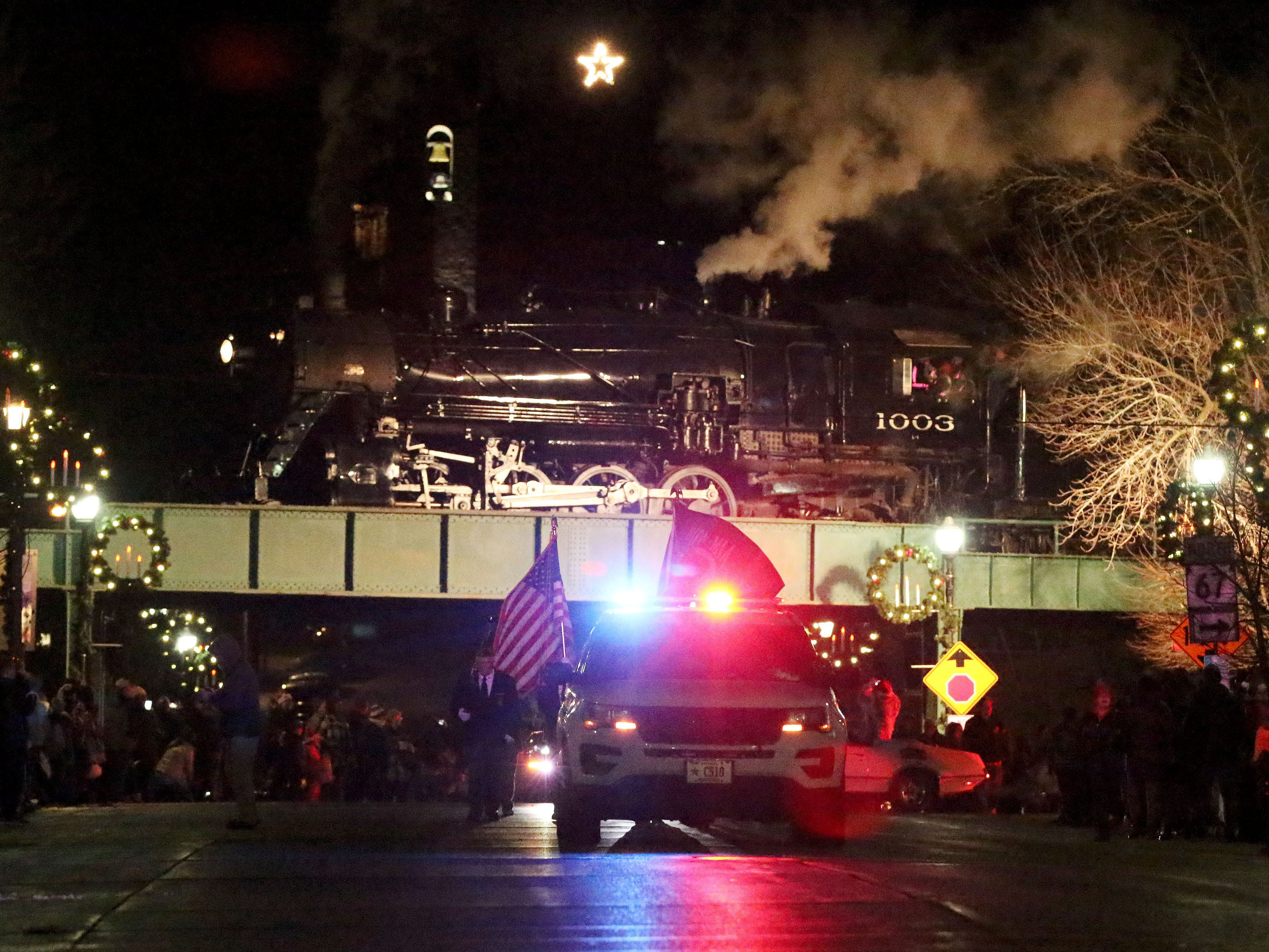 The Christmas Train is a backdrop for the  Plymouth Christmas Parade, Friday, November 23, 2018, in Plymouth, Wis.