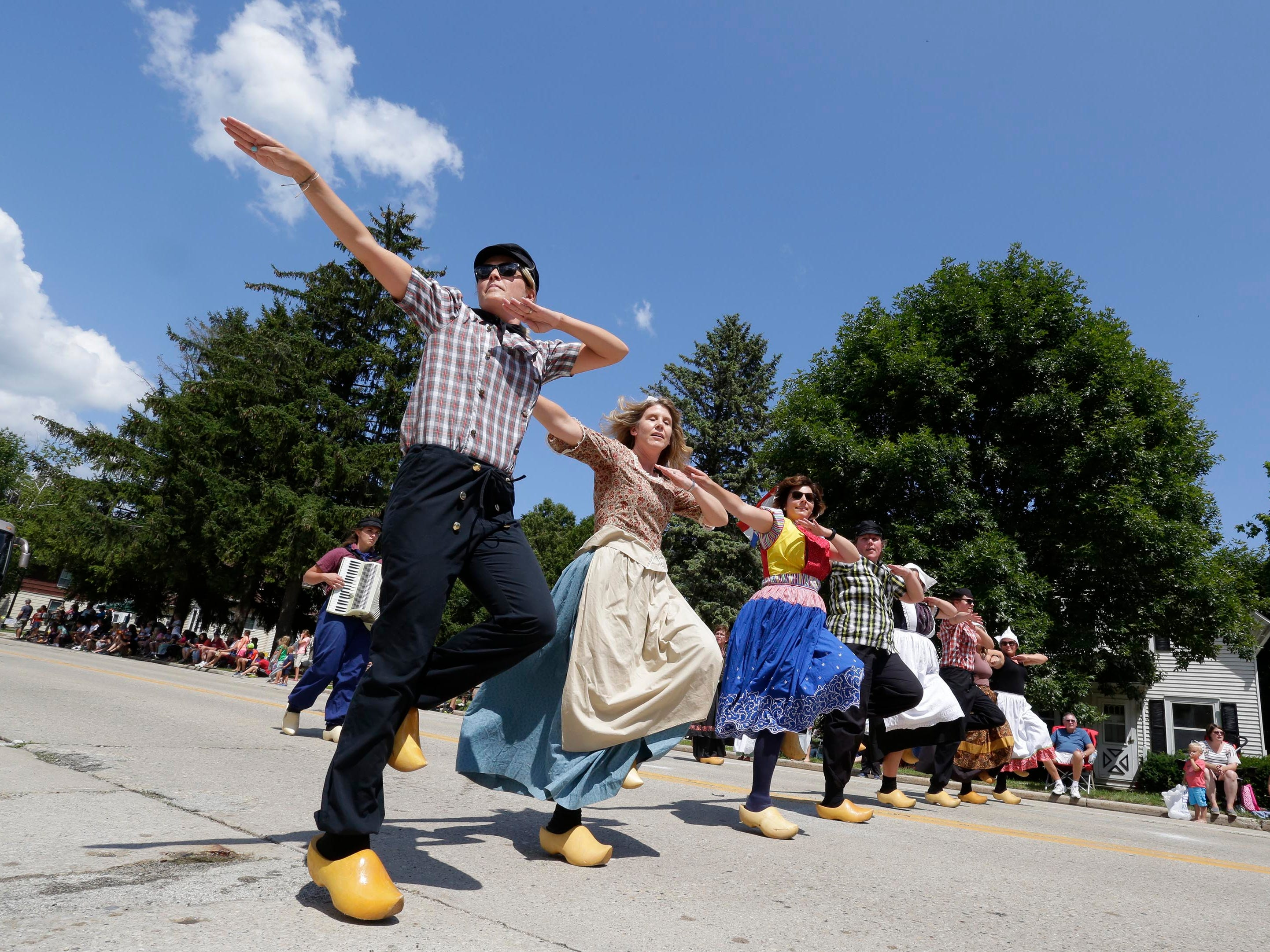 Klompen dancers perform during the 71st Annual Holland Festival parade, Saturday, July 28, 2018, in Cedar Grove, Wis.
