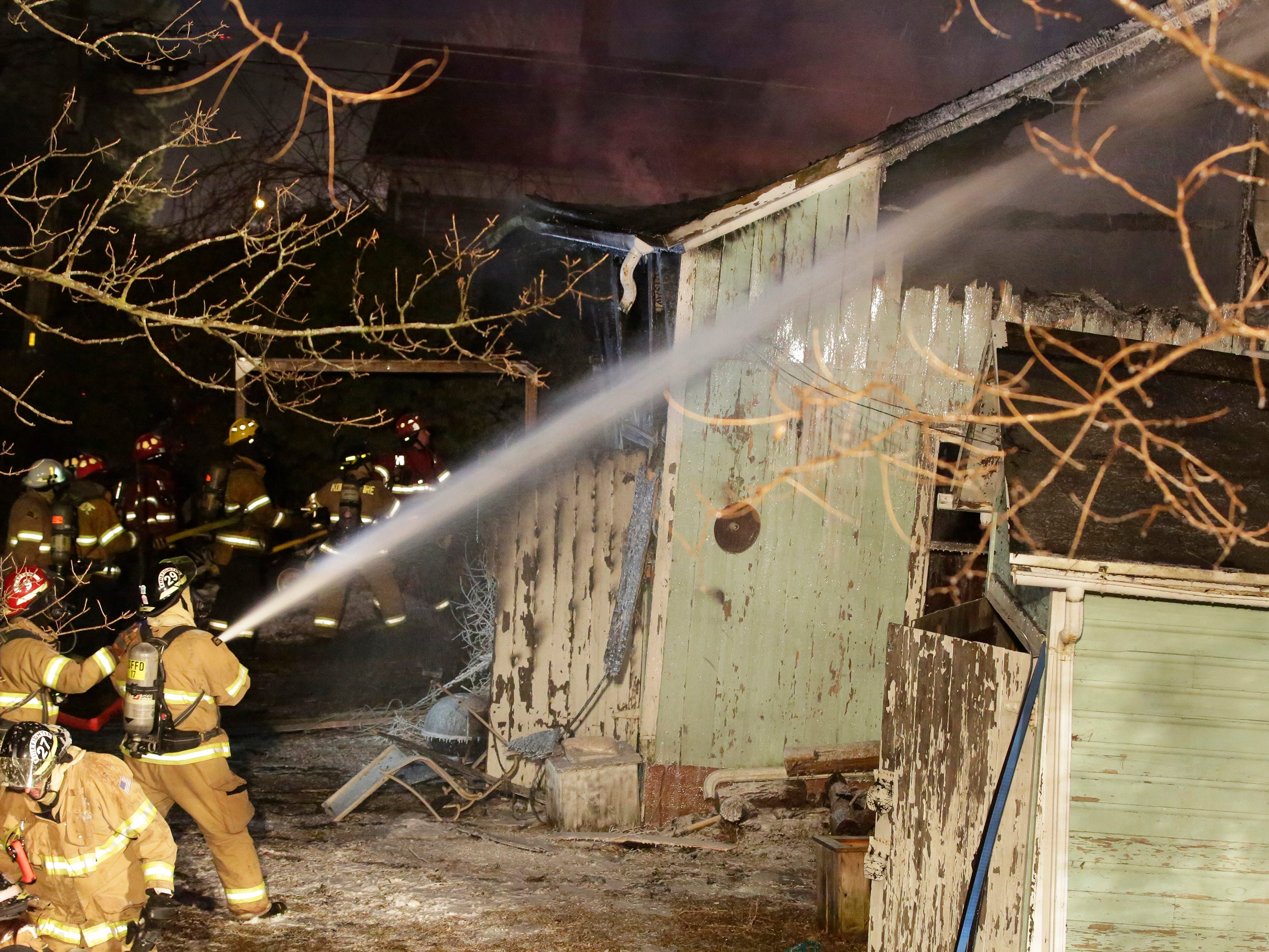 Firefighters work to extinguish the structure fire, Wednesday, February 21, 2018, in Sheboygan Falls, Wis. A building known as the barn caught fire and several departments assisted at the blaze.