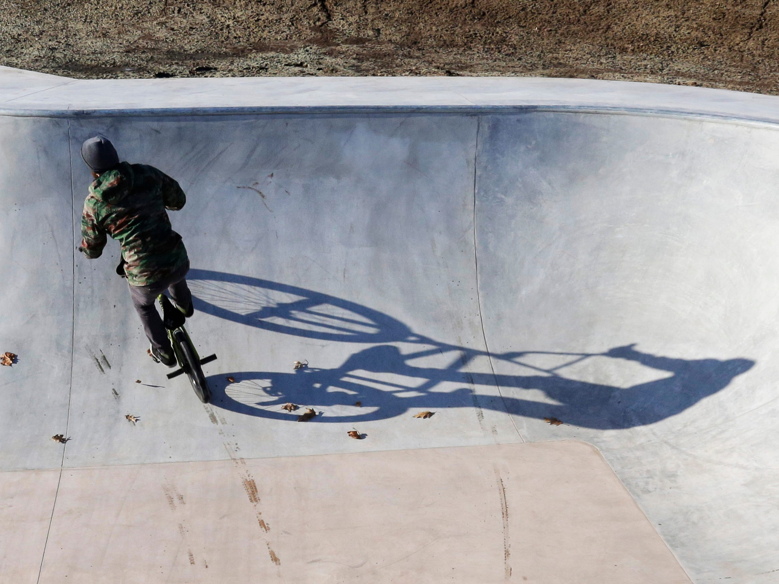 Taylor Thompson of Sheboygan, rides with his shadow in the bowl at the new skate park at Kiwanis Park, Wednesday, January 31, 2018, in Sheboygan, Wis. Thompson said he likes the park and thinks there should be a park like it in every city.