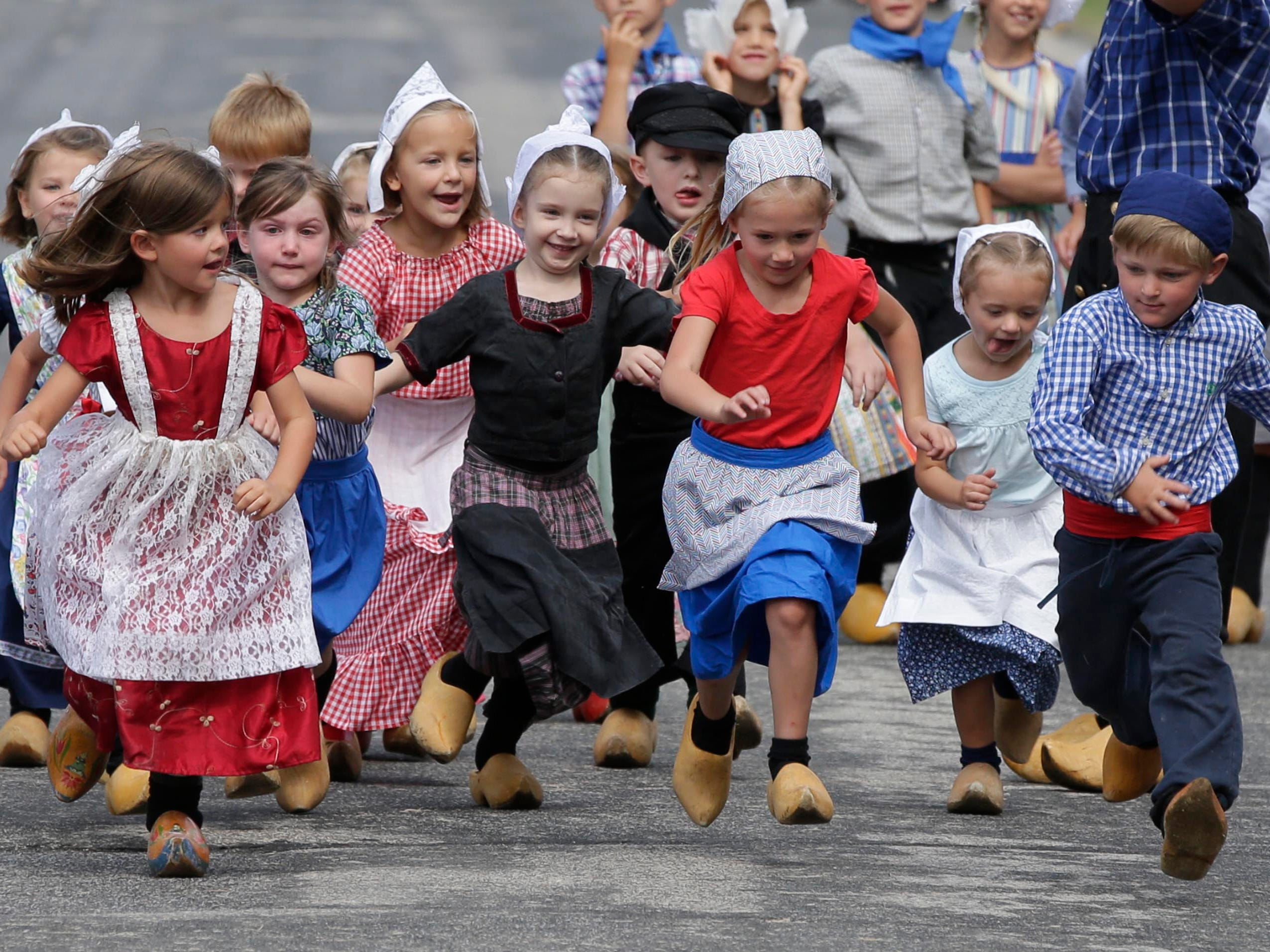 Children have different expressions during the wooden shoe races during the 71st Annual Holland Festival, Friday, July 27, 2018, in Cedar Grove, Wis.