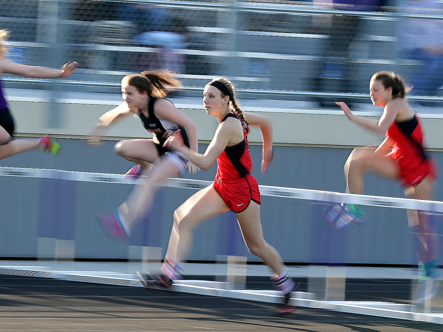 Oostburg's Kennedy Jepson leads the pace in the 100 hurdles finals at the 48th annual Vanderpan Invitational meet, Friday, May 4, 2018, in Sheboygan Falls, Wis.