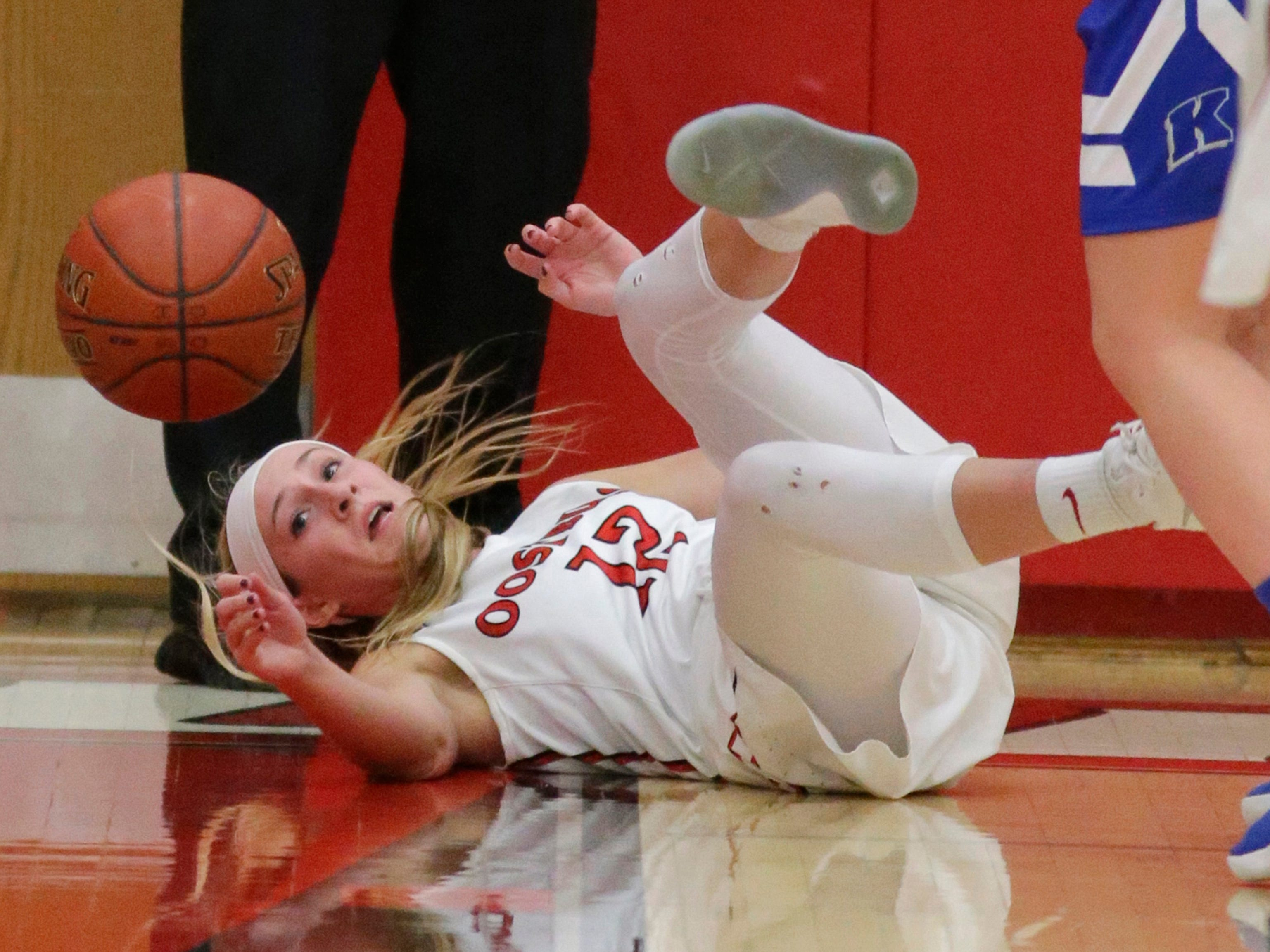 Oostburg's Olivia Meerdink (12) looks up at the ball after scrambling for a loose ball against Kohler, Saturday, February 3, 2018 in Oostburg, Wis.