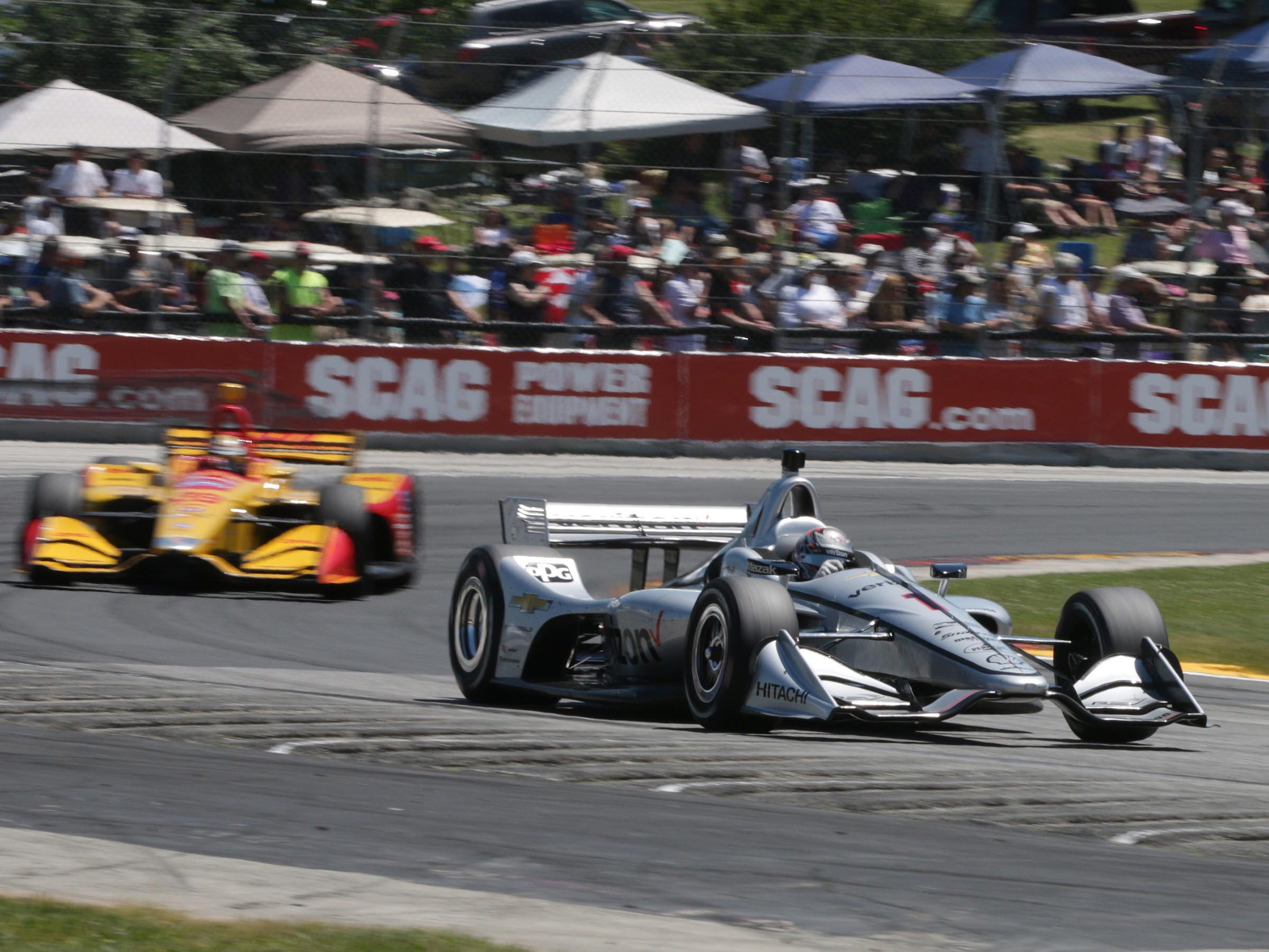 Josef Newgarden (1) leads Ryan Hunter-Reay (28) around turn 5, Sunday, June 24, 2018, during the Kohler Grand Prix at Road America in Elkhart Lake, Wis.