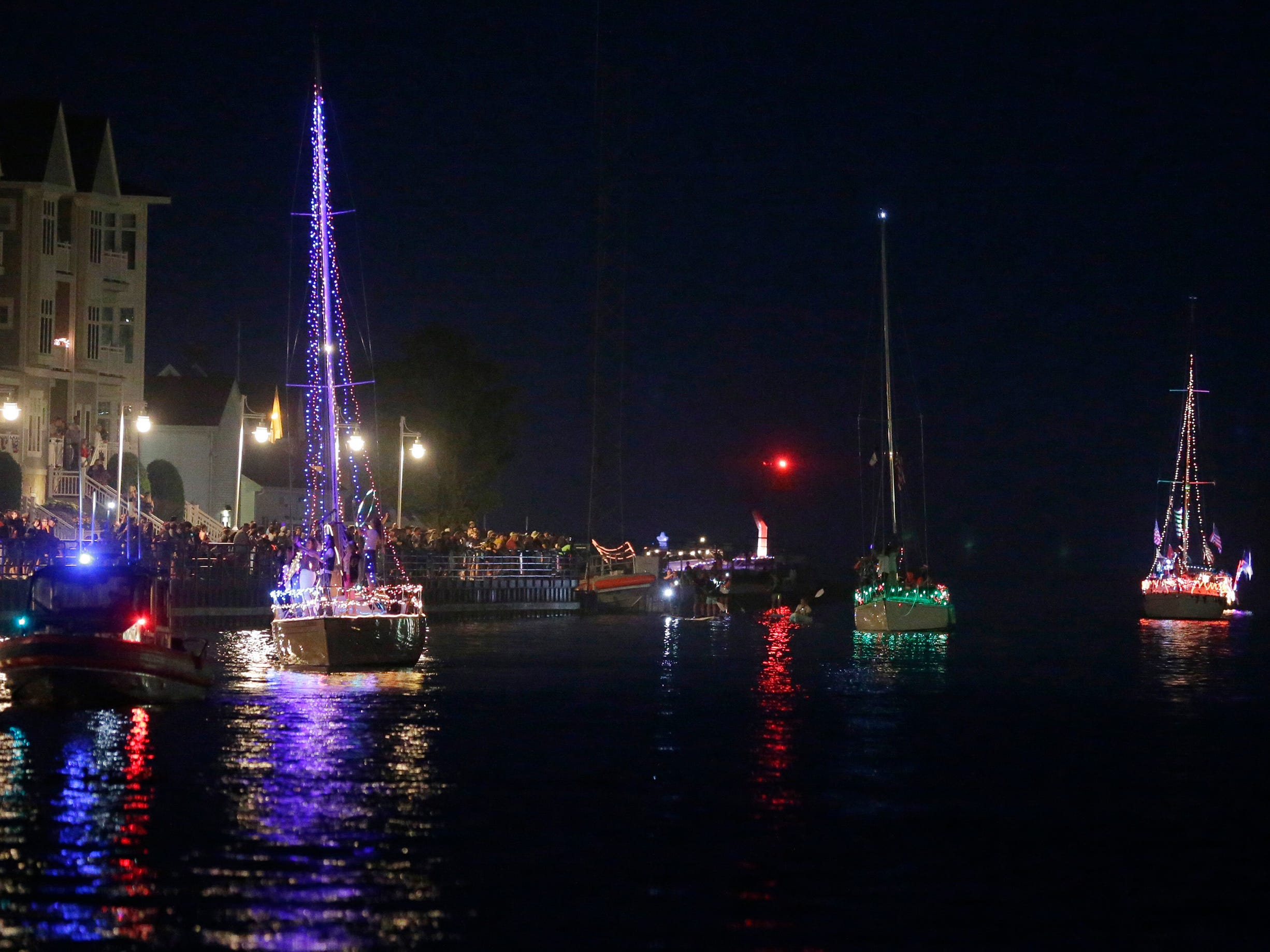 A scene from the Venetian Boat Parade at the Sheboygan Riverfront, Tuesday, July 3, 2018, in Sheboygan, Wis.