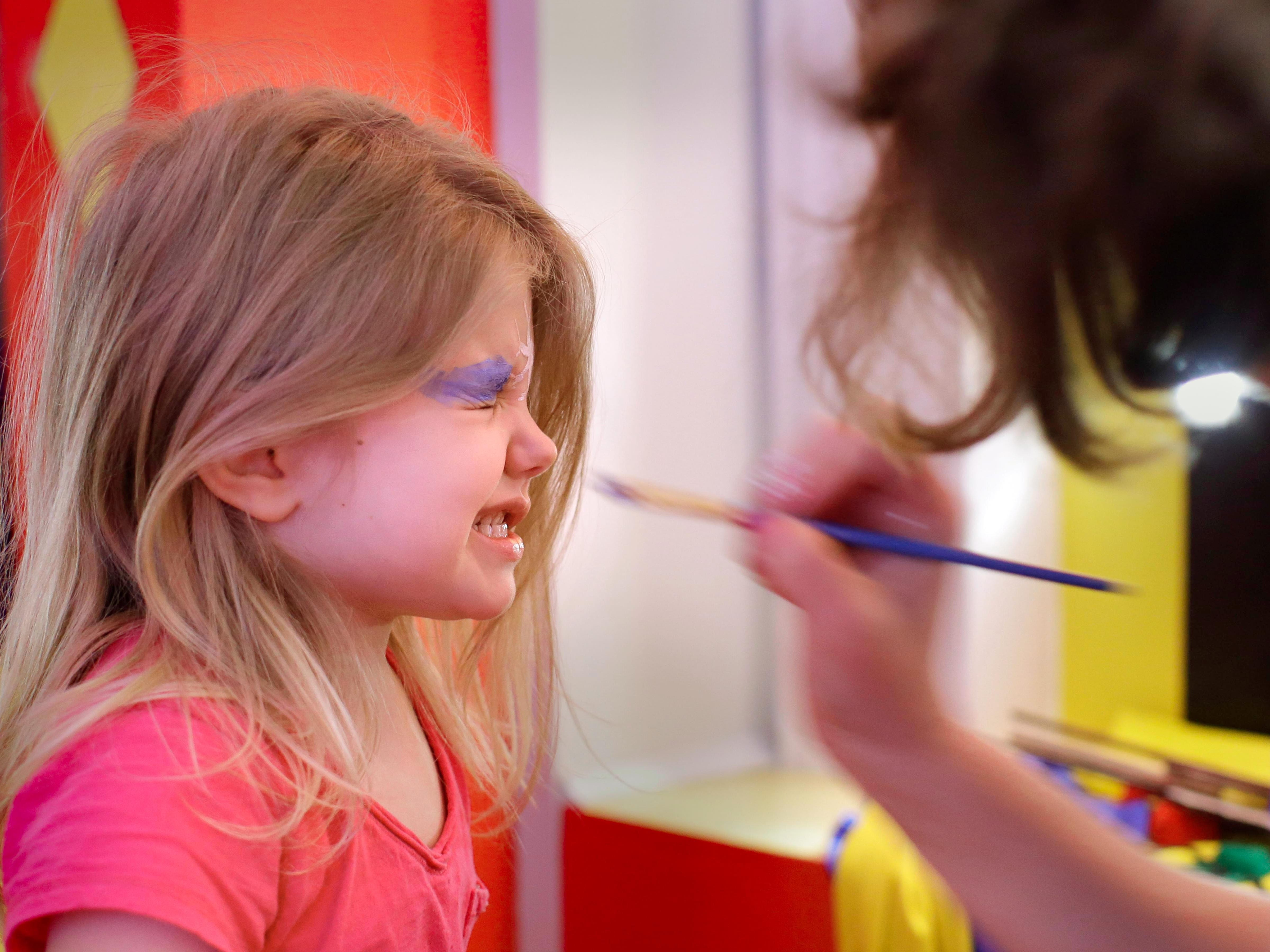 Elizabeth Westphal, 4, of Sheboygan, reacts to being painted during the Above and Beyond Children's Museum's Facepaint Friday, Friday, January 19, 2018 in Sheboygan, Wis.