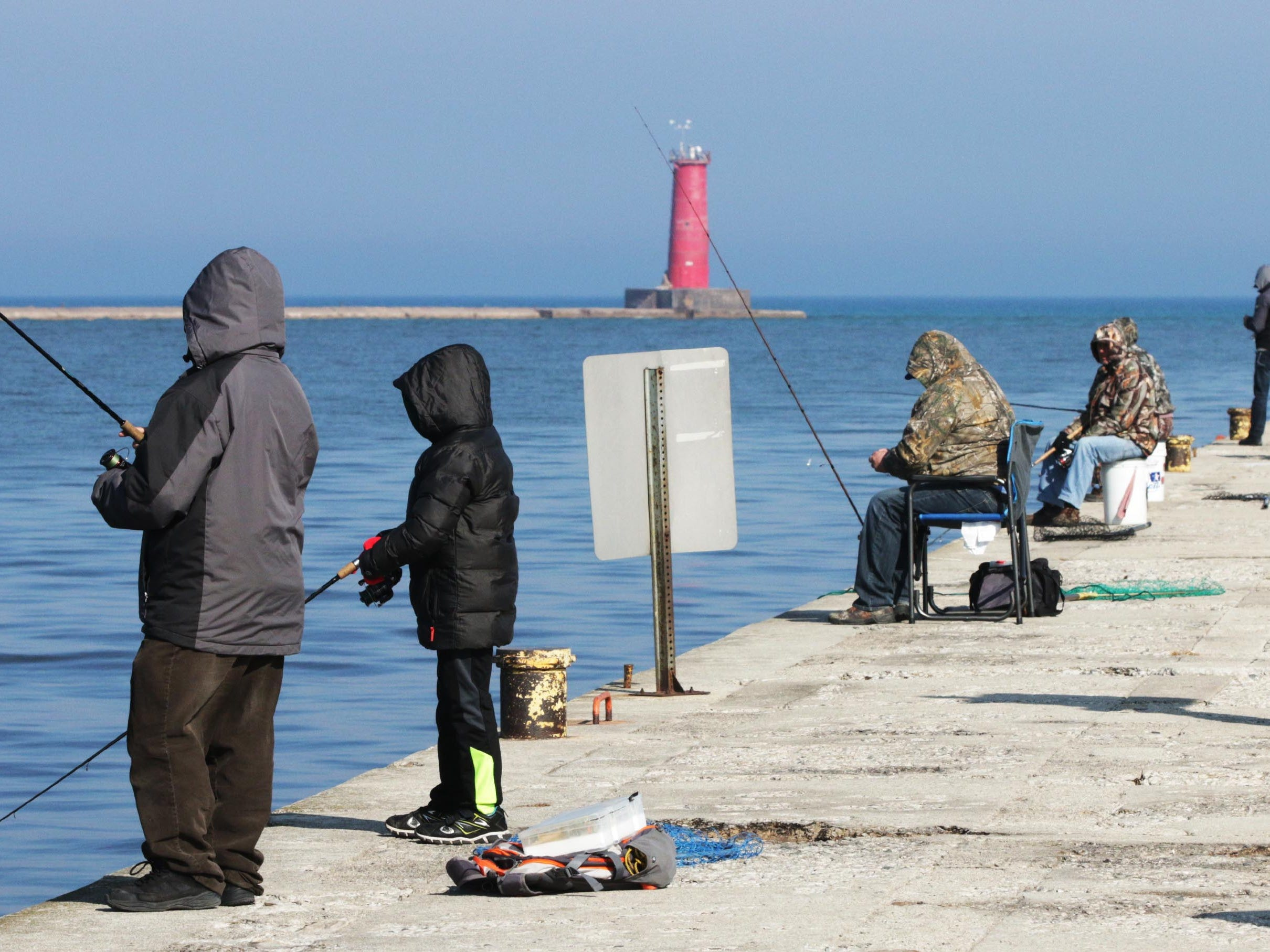 Warmer weather brought out people to south pier to fish, Wednesday, March 28, 2018, in Sheboygan, Wis.