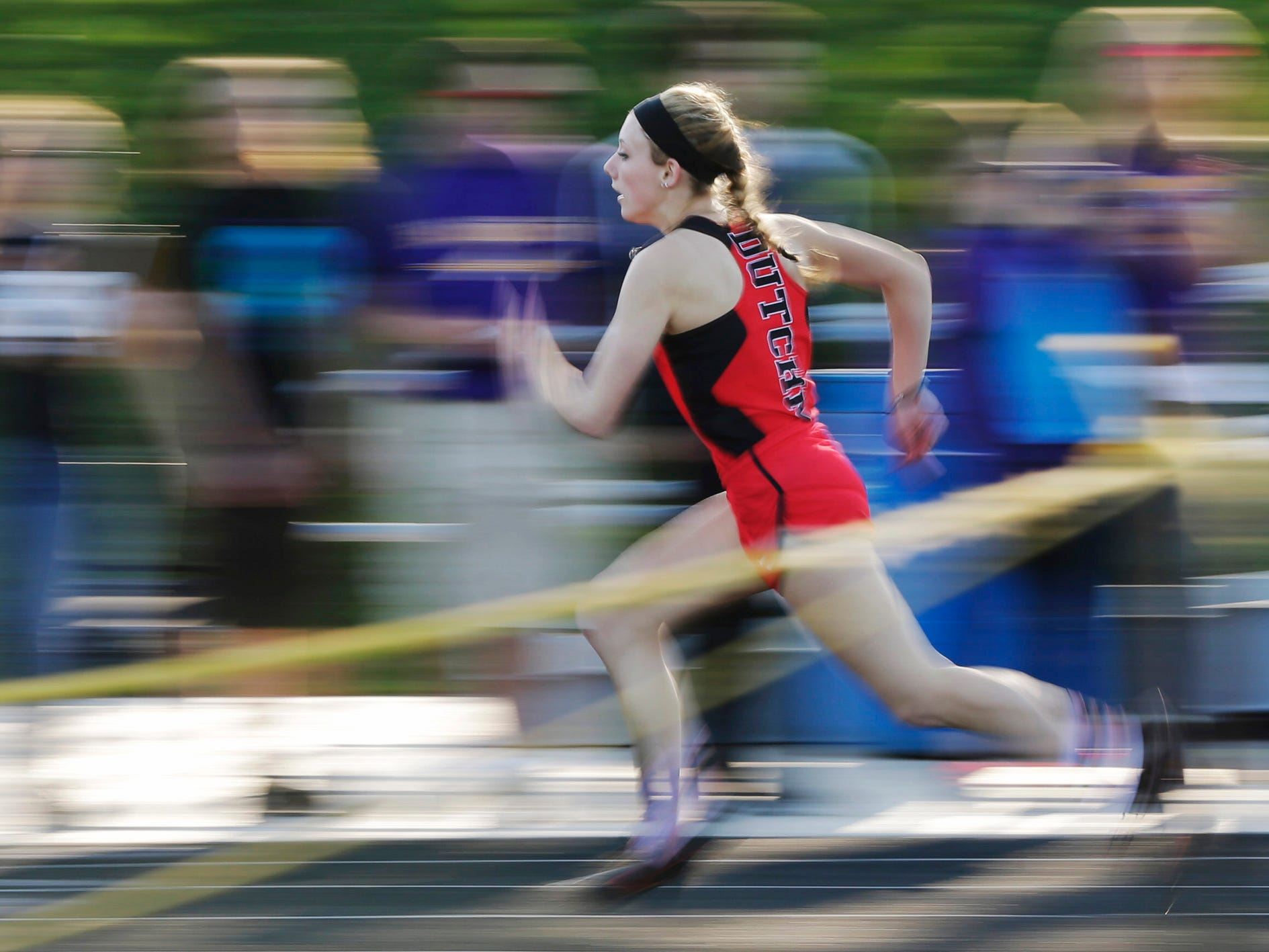 Oostburg's Kennedy Jepson wins in the 100 hurdles finals at the 48th annual Vanderpan Invitational meet, Friday, May 4, 2018, in Sheboygan Falls, Wis.
