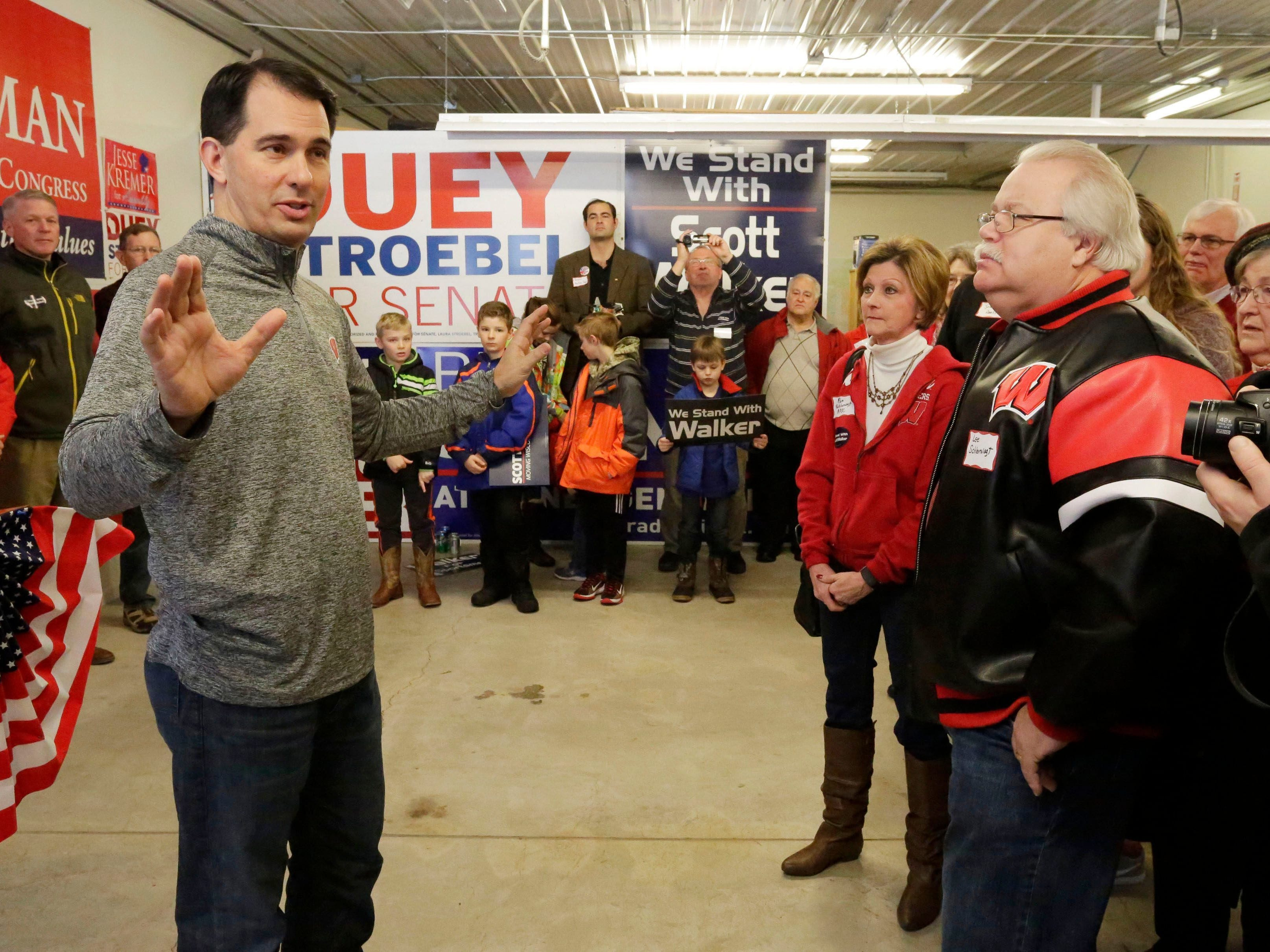 Gov. Scott Walker talks to supporters Saturday at the Sheboygan County GOP headquarters in Sheboygan.  Gary C. Klein/USA TODAY NETWORK-Wisconsin Gov. Scott Walker talks to supporters at the Sheboygan County GOP headquarters, Saturday, January 20, 2017, in Sheboygan, Wis.