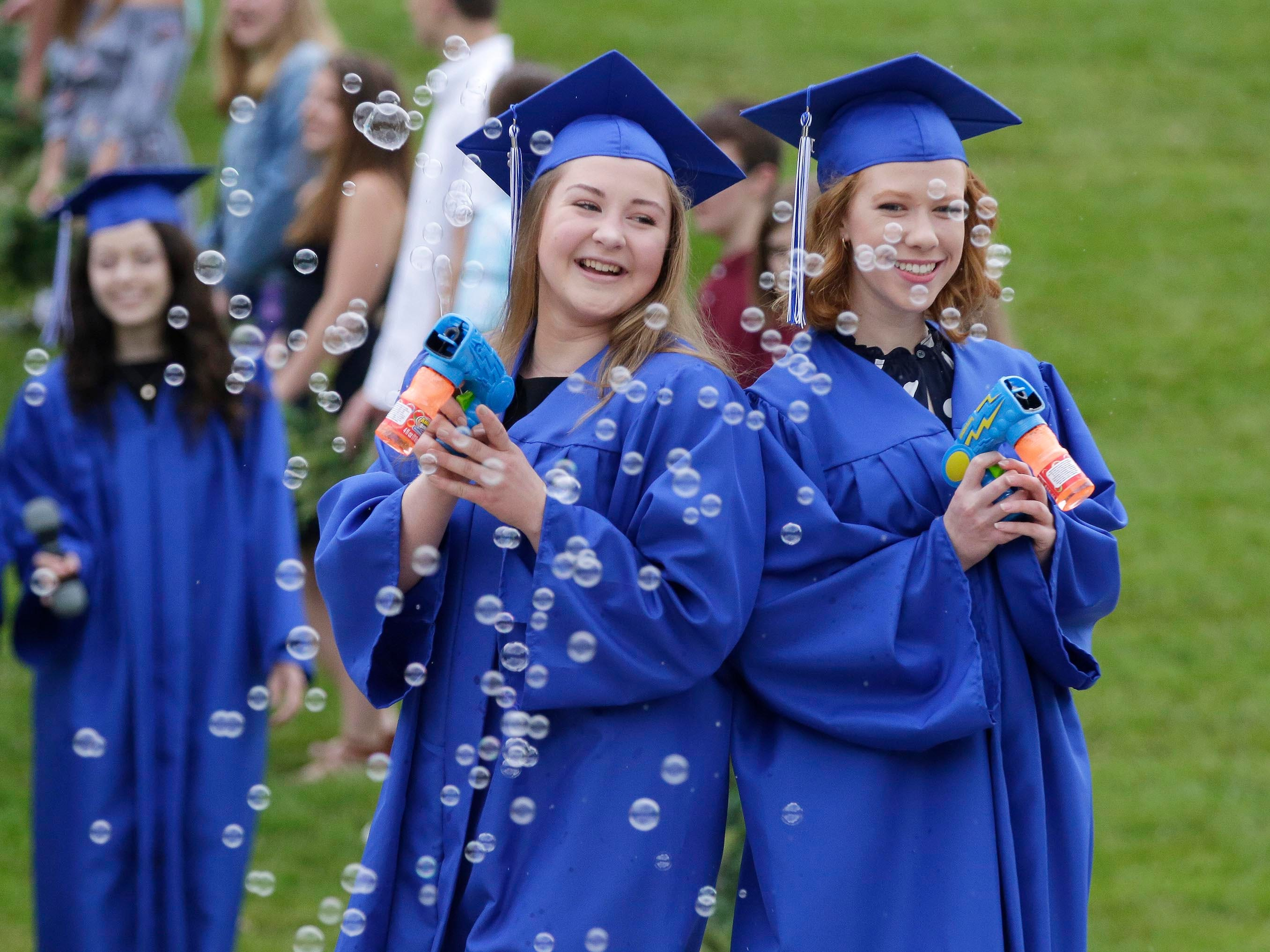 Kohler graduates are bubbly about graduation and Kohler Scroll Night, Wednesday, May 30, 2018, in Kohler, Wis.