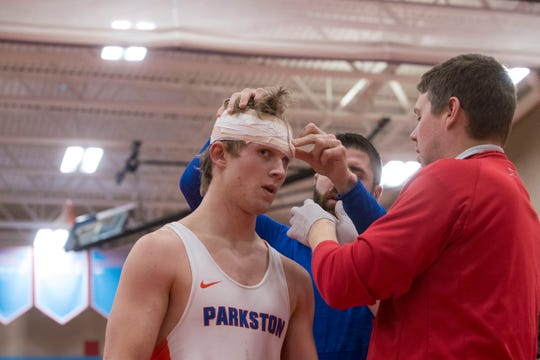 Parkston's Lucas Bietz gets his head wrapped during the Floyd Farrand Invitational, Saturday, Dec. 22, 2018 at Lincoln High School in Sioux Falls, S.D.