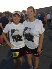 Jaime Mowers and her mom wearing T-shirts with her dad's photo on them.