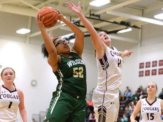 Wilson Memorial's Joya Payne drives to the basket against Stuarts Draft's Hadley May.