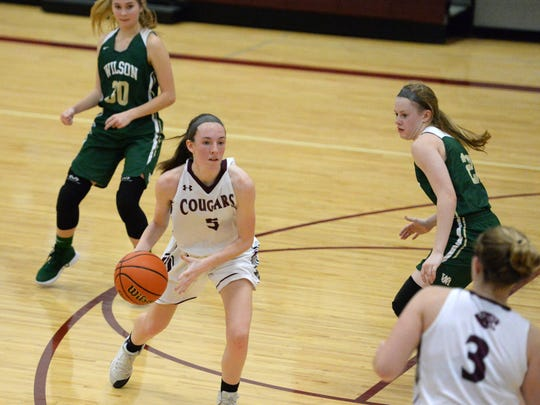 Stuarts Draft's Lyndsay Harris looks for an open teammate Friday in the Cougars win over Wilson Memorial.