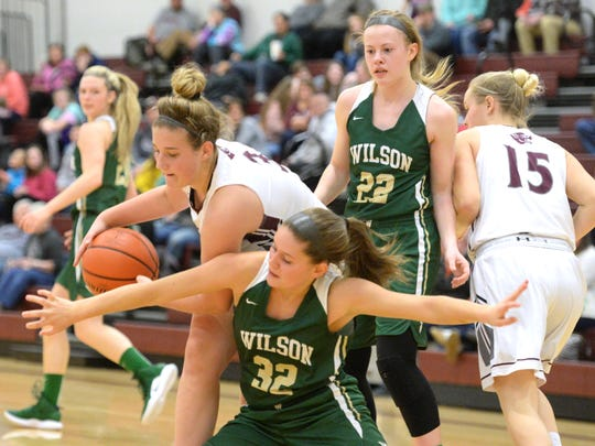 Stuarts Draft's McKinley Fitzgerald tries to maintain control of the ball Friday night during her team's win over Wilson Memorial.