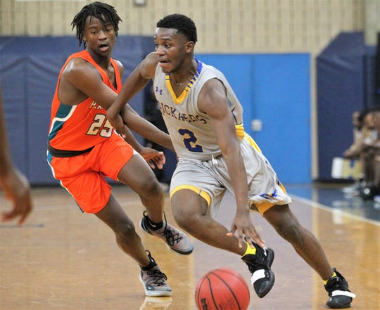 Rickards senior Otis Young drives to the basket during the 2018 Capital City Holiday Classic at TCC.