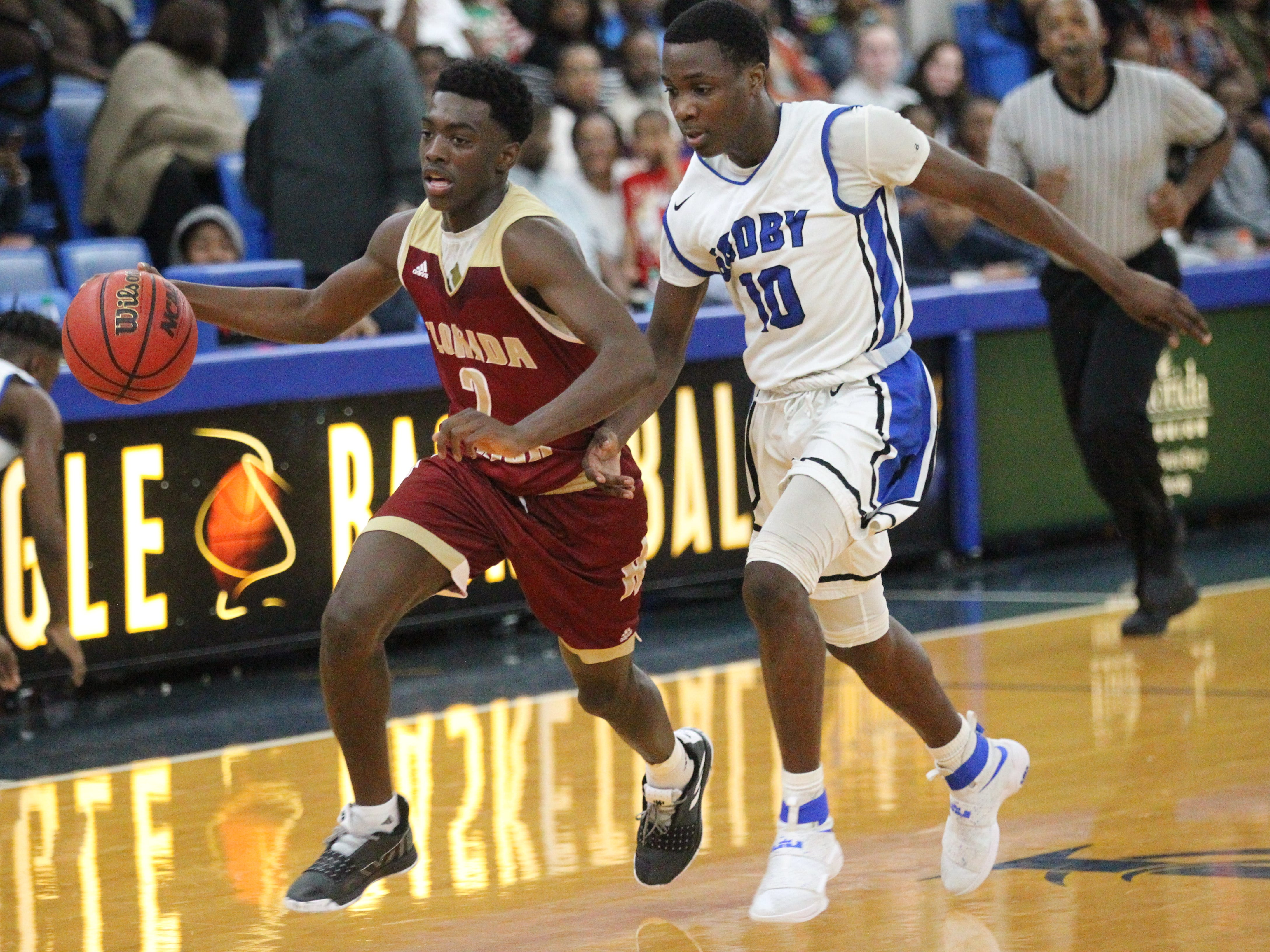 Florida High's Terrion Arnold drives past Godby's Dahron Thomas during the 2018 Capital City Holiday Classic at TCC.