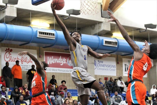 Rickards' Kelvin Dean skies for a layup at the 2018 Capital City Holiday Classic at TCC.