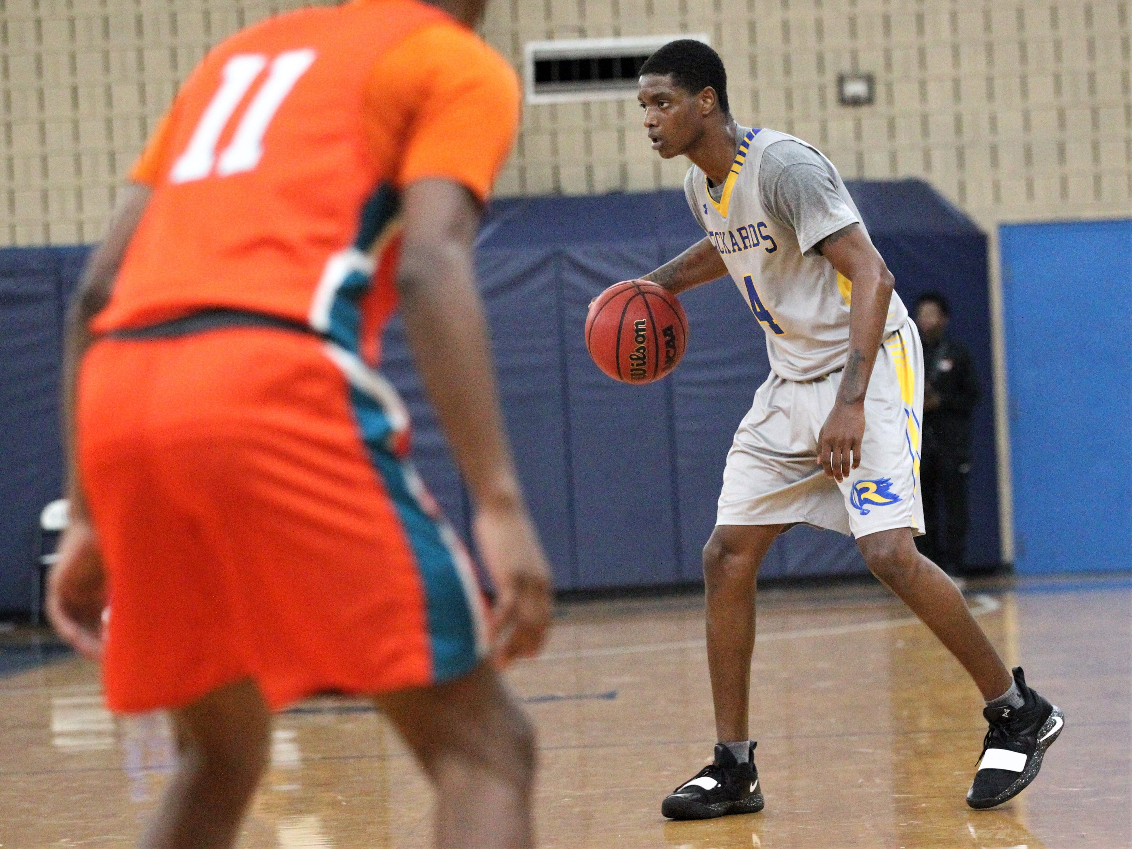 Rickards senior Phillip Russell sets up his team's offense during the 2018 Capital City Holiday Classic at TCC.