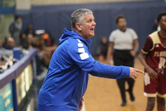 Godby basketball coach Andy Colville directs his team during the 2018 Capital City Holiday Classic at TCC.