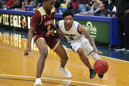 Godby's Tavaris King drives as Florida High's Kent Carroll defends during the 2018 Capital City Holiday Classic at TCC.