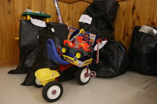 A tricycle and toy truck are headed to a child in need as Love for Liberty helps families impacted by Hurricane Michael by giving out toys and clothes for children, just in time for the holidays, Saturday, Dec. 22, 2018.
