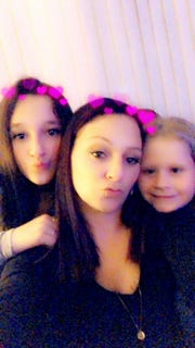 Ericka Gianini, center, took a Snapchat-enhanced selfie flanked by daughters Gabriella, left, and Kayleani on Dec. 21, 2018. It was the first time she'd seen Gabriella in six years.