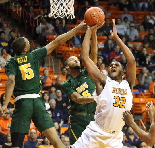 UTEP freshman forward Efe Odigie, 32, takes a shot under pressure from C.J. Kelly, left, and Armani Branch, 5, of Norfolk State during the WestStar Bank Don Haskins Sun Bowl Invitational recently at the Don Haskins Center.