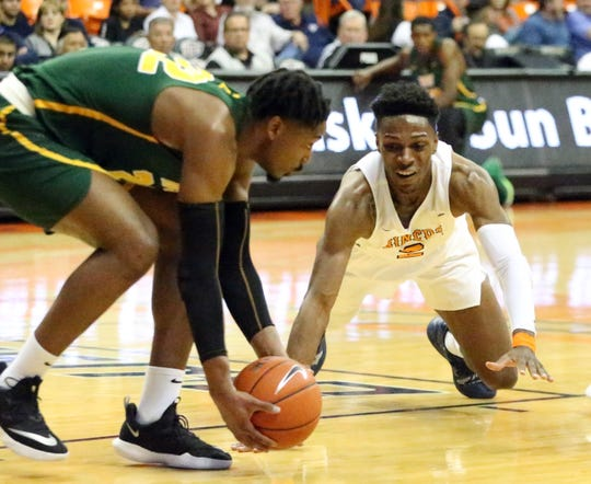 Jordan Lathon, right, of UTEP goes after the ball against Alex Long of Norfolk State in a recent game.