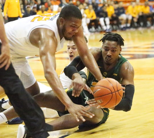 Efe Odigie, top, of UTEP fights for a loose ball against Norfolk State Friday night in the Don Haskins Center.