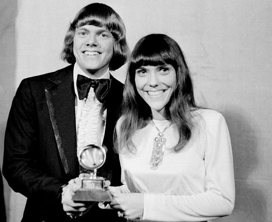 "In this March 17, 1971, file photo, Richard and Karen Carpenter pose with their Grammy in Los Angeles. The brother-sister duo was named best new artist of the year, 1970, and also won as the best contemporary duo or group vocalists for ""Close to You."""