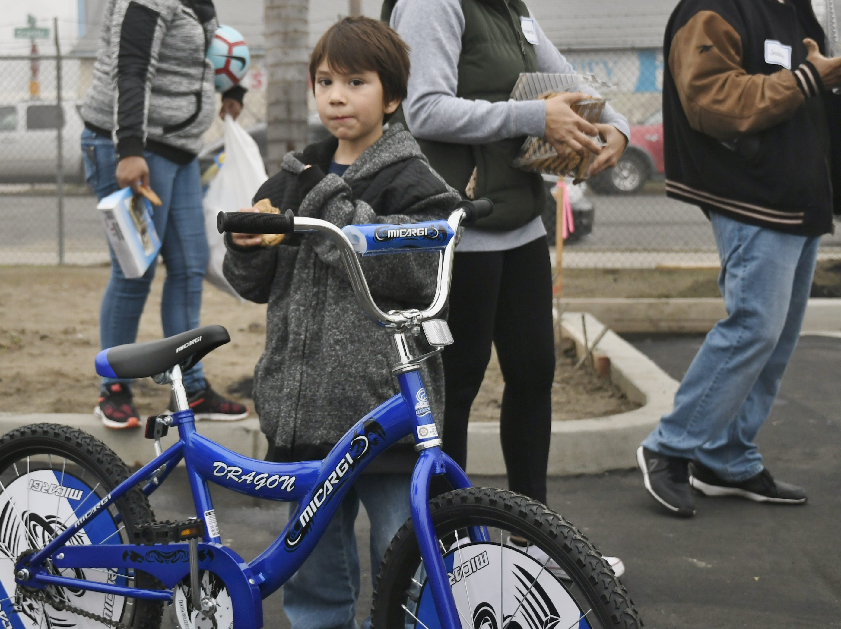 Donovan Martinez was one of 200 Visalia children to get a bike during Visalia Emergency Aid Council's annual bike giveaway.