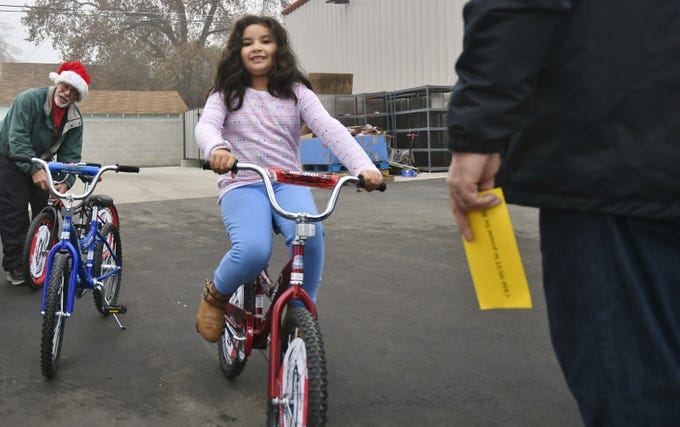Three days before Christmas, 200 bikes were gifted to Visalia Unified School District students at Visalia Emergency Aid Council's annual bike and gift giveaway.