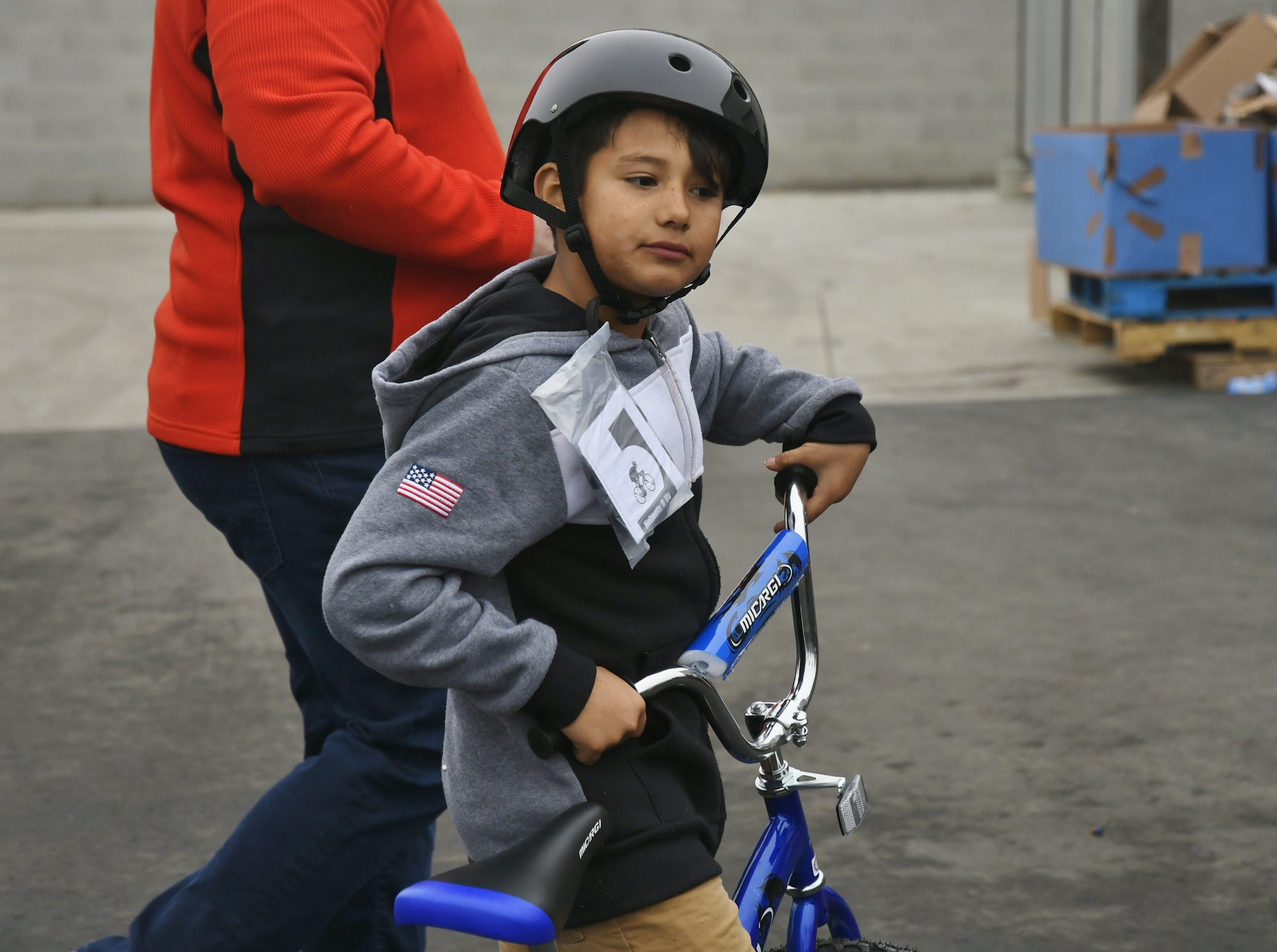 Jesus Martinez was one of 200 children to receive a bike during Visalia Emergency Aid Council's annual bike giveaway on Saturday, Dec. 22.