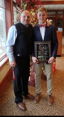 Win Brockmeyer Award winner Elliot Samuels, right, poses with his coach, Paul Michlig, after Friday morning's ceremony.