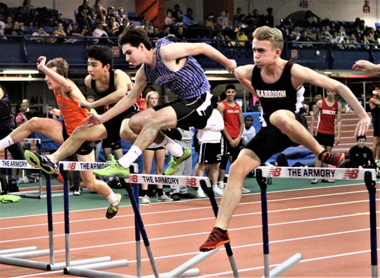 Rye's Zach Rentala, Bronxville's Connor Randall and Harrison's Beck Kerridge compete in boys 55 Jim Mitchell hurdles.