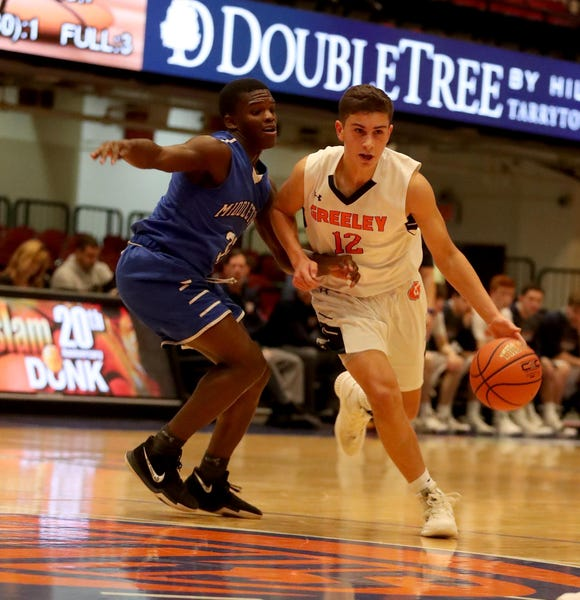 Christopher Sauerborn of Horace Greeley drives against Middletown during a Slam Dunk Basketball Tournament challenge game at the Westchester County Center in White Plains Dec. 22. 2018. Greeley defeated Middletown 72-53.