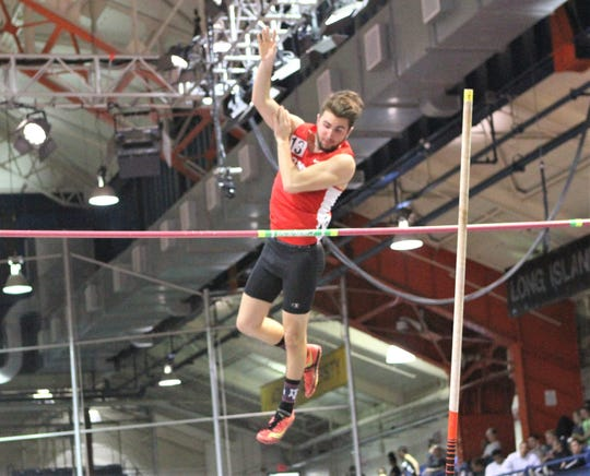 Somers' Josh Tetro clears 11 feet in the pole vault at the Jim Mitchell Invitational.