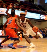 Adrian Griffin Jr. of Stepinac drives on Riginald Hudson of St. Raymond during a Slam Dunk Basketball Tournament game at the Westchester County Center in White Plains Dec. 21. 2018. St. Raymond defeated Stepinac in overtime 72-69.