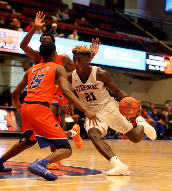 Adrian Griffin Jr. of Stepinac drives during a Slam Dunk Tournament game against St. Raymond at the Westchester County Center. Griffin had 18 points in a playoff loss to St. Raymond on Feb. 19 at Mount St. Michael.