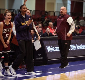 Ossining coach Dan Ricci jumps for joy during the girls Slam Dunk championship game between Ossining and Baldwin at the Westchester County Center in White Plains, Dec. 22, 2018.