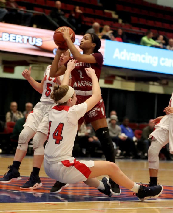 Tanasha Mills of Albertus Magnus drew the could on Meg Nardelli of RC Ketcham during a Slam Dunk Basketball Tournament consolation game at the Westchester County Center in White Plains Dec. 22. 2018.