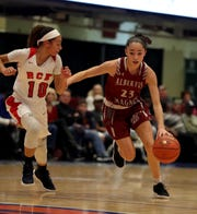 Paulina Paris of Albertus Magnus drives on Mya Smith of RC Ketcham during a Slam Dunk Basketball Tournament consolation game at the Westchester County Center in White Plains Dec. 22. 2018.