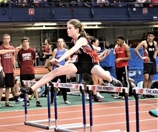 Rye's Kaitlyn McGuire competes during the girls 55 Jim Mitchell hurdles.