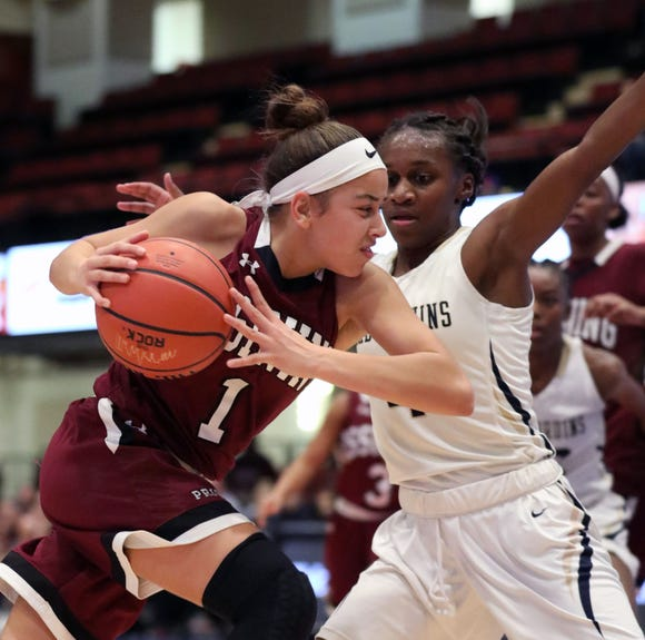 Ossining's Jaida Strippoli drives toward the basket as Baldwin's Kaia Harrison defends during the girls Slam Dunk championship game between Ossining and Baldwin at the Westchester County Center in White Plains, Dec. 22, 2018.
