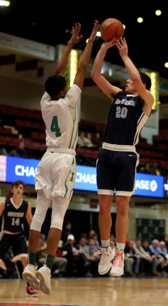Will Krebs of Suffern shoots over James Rhodes of Irvington during a Slam Dunk Basketball Tournament challenge game at the Westchester County Center in White Plains Dec. 22. 2018. Suffern defeated Irvington 48-35.