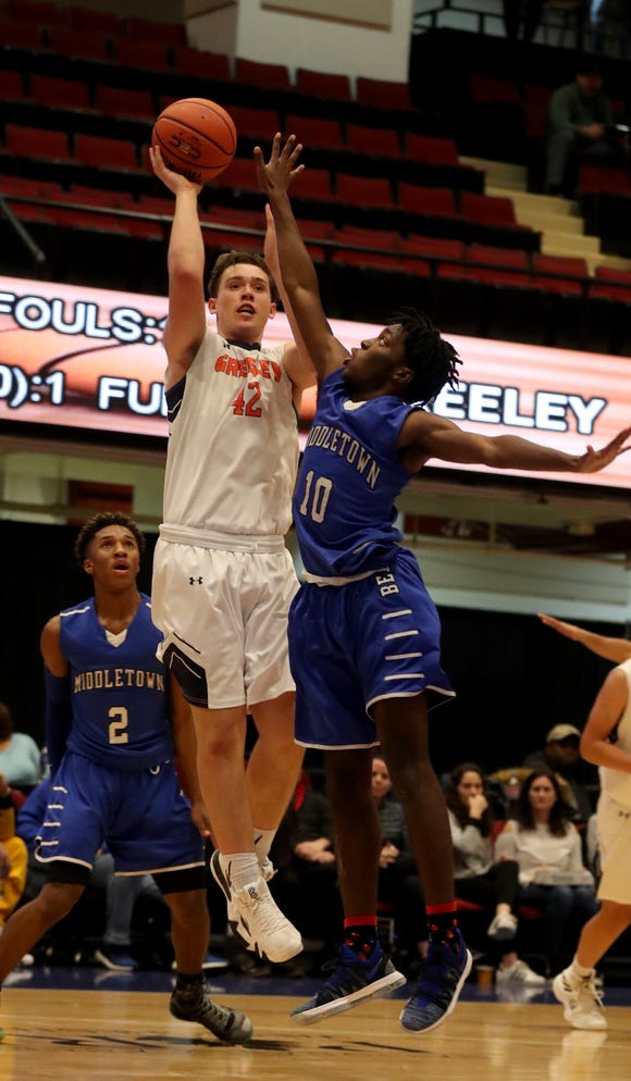 Nicholas Townsend of Horace Greeley shoots over Ryan Rosa of Middletown during a Slam Dunk Basketball Tournament challenge game at the Westchester County Center in White Plains Dec. 22. 2018. Greeley defeated Middletown 72-53.