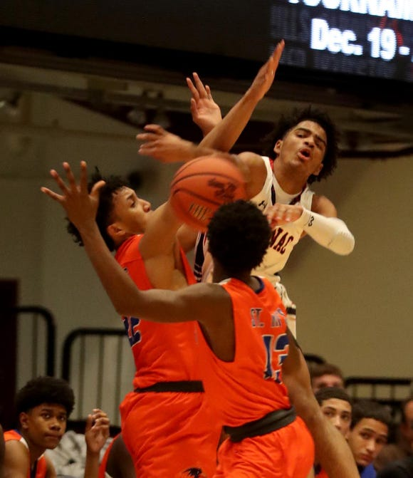 RJ Davis of Stepinac gets tied up with St. Raymond defenders during a Slam Dunk Basketball Tournament game at the Westchester County Center in White Plains Dec. 21. 2018. St. Raymond defeated Stepinac in overtime 72-69.