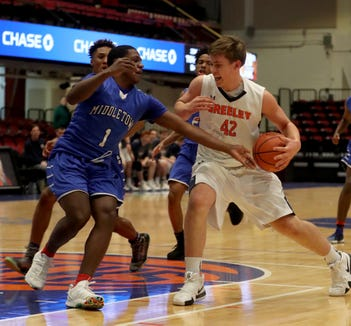Nicholas Townsend of Horace Greeley is defended by Marquis Gill of Middletown during a Slam Dunk Basketball Tournament challenge game at the Westchester County Center in White Plains Dec. 22. 2018. Greeley defeated Middletown 72-53.
